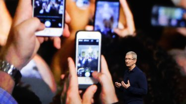 Apple CEO Tim Cook announcing the new iPhone 7 on Wednesday.