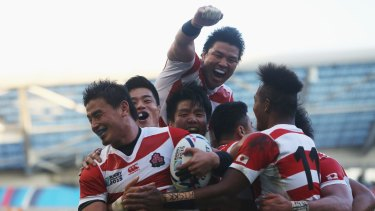 History: Japan celebrate their upset win over two-time champions South Africa.