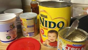 Open tins of baby formula were littered around the kitchen.