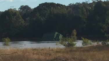 One of the two tanks dislodged by the floodwaters.