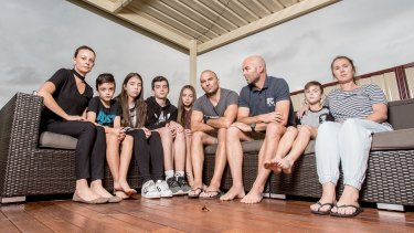 Brothers Craig and Cameron Zammit (pictured with their wives, Michelle and Belinda, and children) are taking up a fight to work flexible hours to help look after their children.