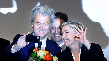 France's Marine le Pen (right) and Dutch populist anti-Islam lawmaker Geert Wilders. Hirsi Ali says such anti-establishment powerbrokers gain traction because the experiences of the general public are being ignored.