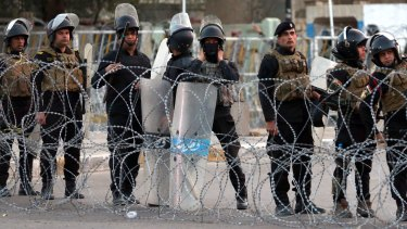 Attacks continue ... Iraqi security forces close a bridge leading to the heavily guarded Green Zone on Friday.