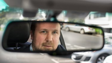 Hire car driver Adam Lust has applied to the government's Taxi Fairness Fund.