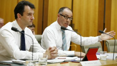 National Australia Bank chief executive Andrew Thorburn (right) and chief operating officer Antony Cahill have faced a testy hearing at Parliament.