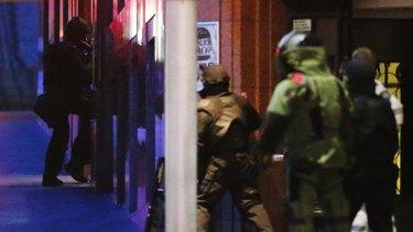 Police raid the Lindt cafe.