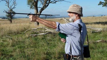 Professor George Wilson, seen here retrieving GPS collars used to track kangaroos in the ACT, says farmers need to have an interest in safeguarding kangaroos.