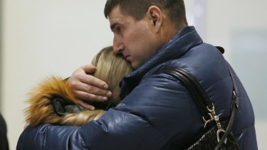 Relatives react after a Russian airliner with more than 200 passengers crashes in Egypt.