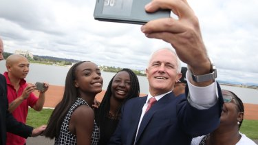 Malcolm Turnbull takes a selfie with new Australian citizens Lydia Banda-Mukuka and Chilandu Kalobi Chilaika on Australia Day last year.