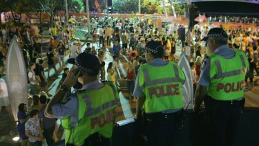 Police officers watch over the schoolies week celebrations in Surfers Paradise. The study found that revellers who did get into trouble would be most likely to turn to their friends for help.