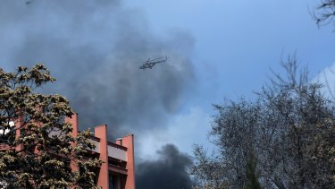 Afghanistan's Army helicopters fly over the biggest military hospital after the clash started between insurgent fighters and army soldiers.