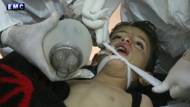 Syrian doctors treat a child following a suspected chemical attack in Syria on April 4, 2017.
