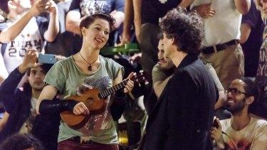 Gaiman with his wife Amanda Palmer performing at a free show in Tel Aviv, Israel.