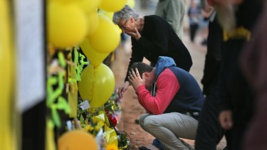 Merrilyn Scott and Aaron Leeson-Woolley at the memorial to Stephanie in the days after her body was found.
