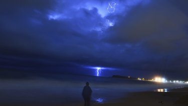 Storm which brought hail to parts of Sydney moves off the coast , shot from Narrabeen.