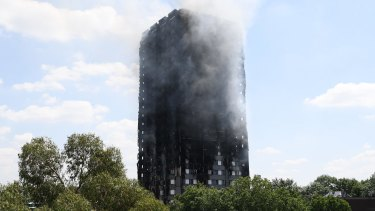 Smoke continues to rise from the burning 24-storey Grenfell Tower block in Latimer Road, west London.