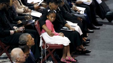 Malana Pinckney, daughter of Reverand Clementa Pinckney, is hugged by her mother Jennifer at the start of her father's funeral  at the Emanuel African Methodist Episcopal Church in Charleston, South Carolina.