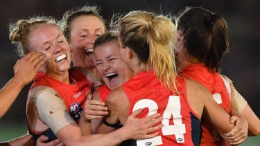 Melbourne celebrate their first ever win in the AFLW on Saturday night.