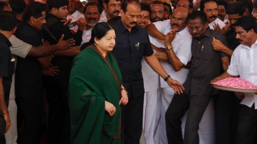AIADMK party leader Jayaram Jayalalithaa arrives to offer a floral garland to a portrait of party founder MG.Ramamchadran last year.