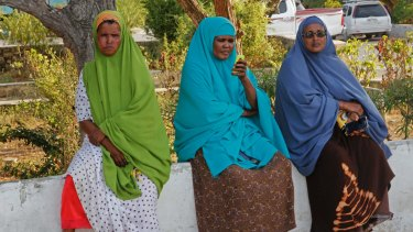 Somali women wait for news of their missing relatives outside a hospital ward in Mogadishu two days after the attack.