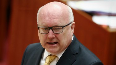 Attorney-General George Brandis will introduce new laws targeting foreign spies, agents and donations to parliament by the end of the year.