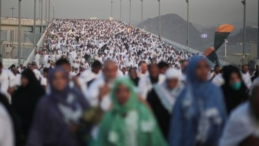 Crush: Hundreds of thousands of pilgrims make their way to perform the last rite of the Haj.