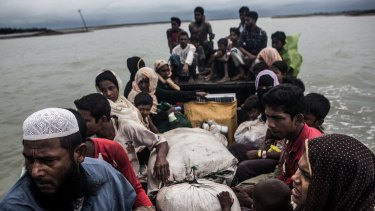 Rohingya refugees arrive by boat from Myanmar, near Teknaf, Bangladesh in September.