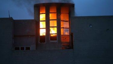 A house burns in Sinjar, northern Iraq.