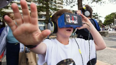 Nick and Ben Layton using iChicken virtual reality gear at Manly Wharf.