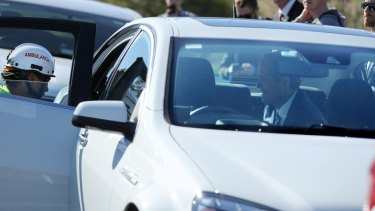 Bill Shorten comforts one of the drivers and her son in the back of his official car.