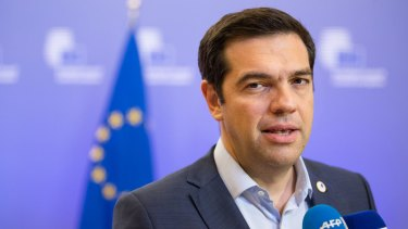 'We fought hard abroad, we must now fight at home against vested interests' ... Greek Prime Minister Alexis Tsipras speaks to journalists following bailout talks in Brussels, Belgium.