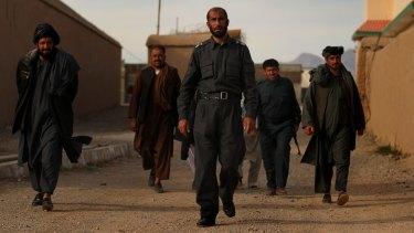 Matiullah Khan and his men at his compound in Tarin Kowt in January 2013.