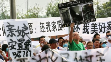 The state is struggling to contain public anger over the sharemarket collapse and the recent explosions at Tianjin, where these protesters took to the streets.
