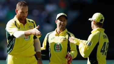 Handy work:  John Hastings congratulates Steve Smith after the dismissal of India's Ajinkya Rahane.