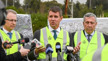 NSW Premier Mike Baird, centre, Roads Minister Duncan Gay, right, and Federal Minister for Urban Infrastructure Paul Fletcher at the Rozelle Rail Yards.