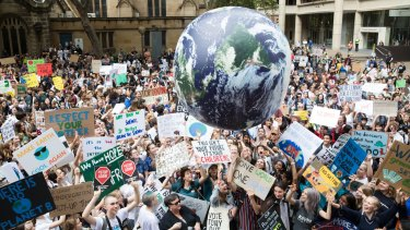 Students go on strike from school to protest at a climate change rally.