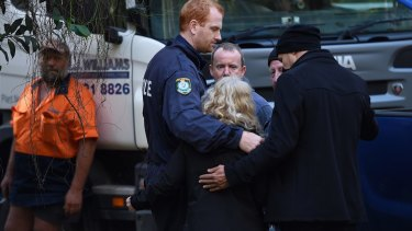 NSW Detectives embrace Matthew Leveson's parents Mark and Faye after locating the possible burial place of their son.