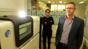 Professor Ben Howden (right), director of the Microbiological Diagnostic Unit at Melbourne's Doherty Institute, with Dr Jason Kwong and the gene sequencer that helped St Vincent's trace the source of a superbug infection in 2015 to a single toilet bowl.
