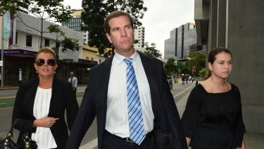 Former Billabong chief executive Matthew Perrin, arrives at court in December with his new partner, Belinda Otten (left) and his daughter.