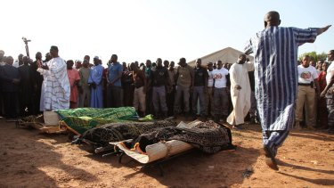 The remains of people slain by gunmen during recent attacks in Mali's capital are laid out during a funeral in Bamako.