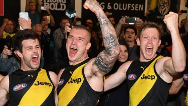 Richmond players Trent Cotchin, Dustin Martin and Jack Riewoldt celebrate their win on Saturday.