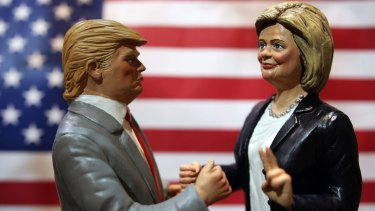 Statuettes depicting the presidential candidates Donald Trump, left, and Hillary Clinton in a shop in Via San Gregorio Armeno, the street of nativity scene craftsmen, in Naples, Italy.