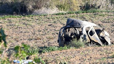 The wreckage of the car of investigative journalist Daphne Caruana Galizia lies next to a road in the town of Mosta, Malta.