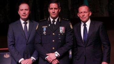 Australian Border Force commissioner Roman Quaedvlieg, centre, with Peter Dutton and then prime minister Tony Abbott.