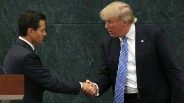 Mexican President Enrique Pena Nieto, left, and Donald Trump shake hands after a joint statement in Mexico City in August 2016.