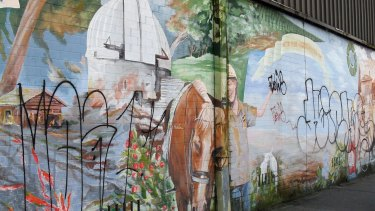 The mural in Cooleman Court defaced by tags and graffiti