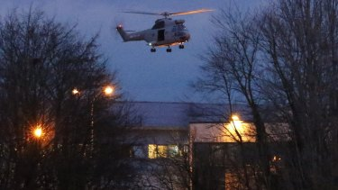 A helicopter hovers after the final assault at the scene of a hostage taking at an industrial zone in Dammartin-en-Goele, north-east of Paris.