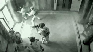 CCTV shows tactical police entering the Lindt cafe at 2.13am on December 16, 2014.