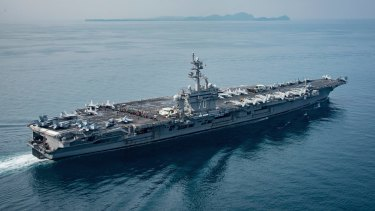 In this Saturday, April 15, 2017 photo released by the U.S. Navy, the aircraft carrier USS Carl Vinson transits the Sunda Strait between the Indonesian islands of Java and Sumatra.