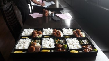 At Hotel Hirohama, which comprises mainly serviced apartments, kitchen staff prepare bento boxes.